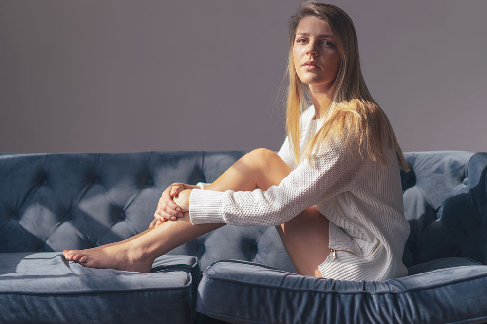 on the couch sitting natural light portrait
