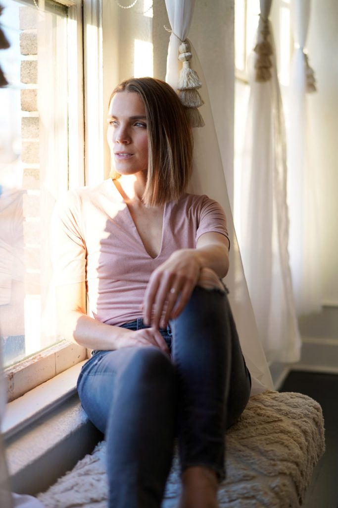 resting by the window with 50mm lens portraits
